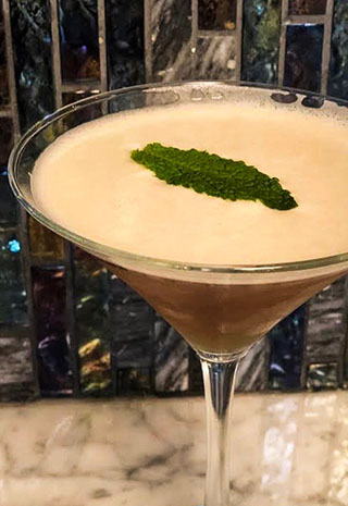 Cocktail with mint garnish