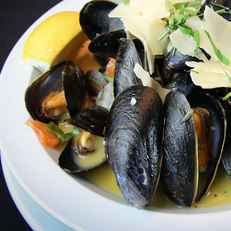 Mussels on plate with garnish