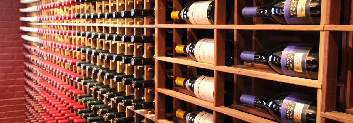 Wine bottles stored in wine cellar