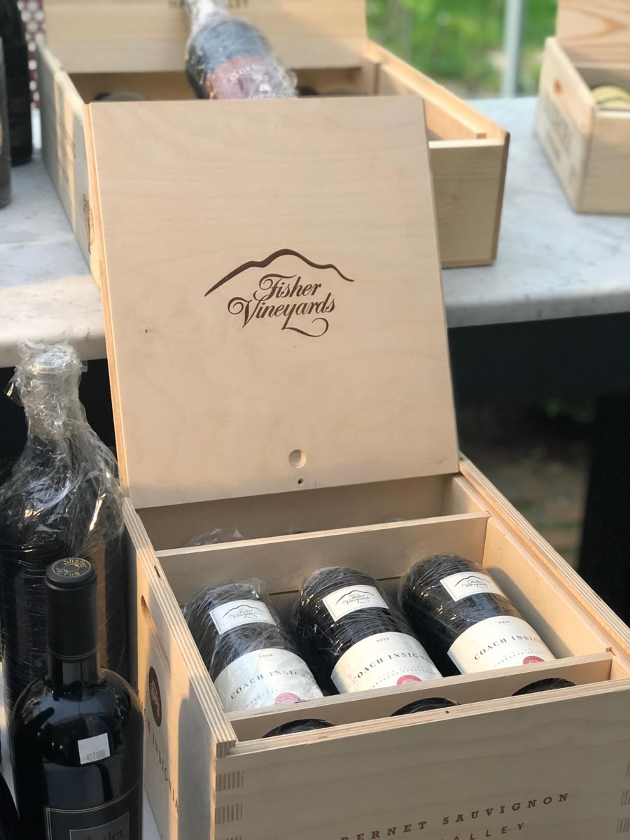 Wine displayed in wooden box for retail wine night