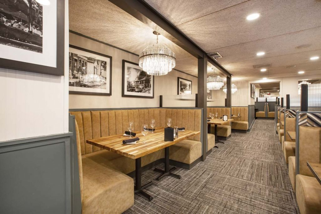 Booth seating with large format black and white photography on walls