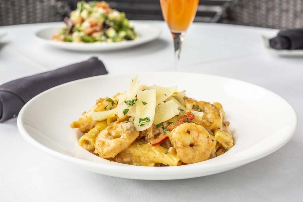 Tucci's rigatoni with shrimp garnished with shaved parmesan